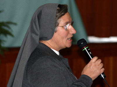 "Rome. Sr. Anna Razionale, provincial of Italy IMR, offered the capitulars the book ""My Dear Albania,"" for the feast of Our Lady of the Rosary."