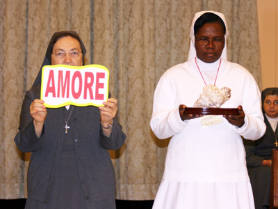 Rome. The Sisters of the province of Haiti animate the Mass. La Madre and Sr. Marie Adline Clergé, provincial of Haiti, carry symbols during the entrance procession.