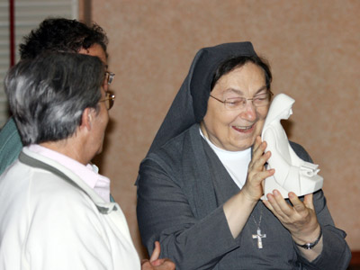 Rome. Vigil of the Feast of St. Teresa of Avila. The Sisters of the Spanish province SMA give La Madre a statue of the patron saint.