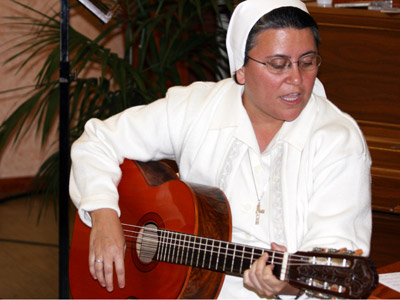 Rome. Sr. María Eugenia Ramos, provincial of Venezuela, plays the guitar for the closing hymn of the Good Night.