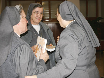 Rome. Mother Antonia with Sr. Maria Pia Bianco and her book, during the Good Night to the Generalate community.