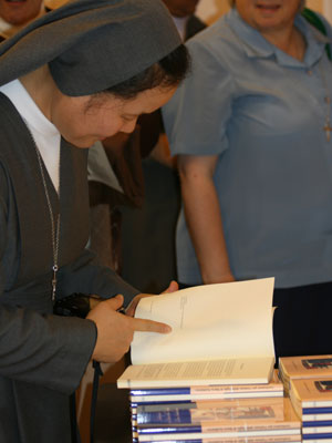 Rome. The Sisters receive the photographed copy of the first Constitutions corrected by Saint John Bosco, manuscript D.