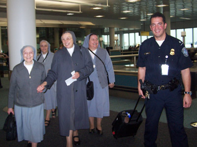 "New Jersey. Visit of M. Yvonne Reungoat to the province ""St. Philip the Apostle"" (SUA). With an ""official police escort"" from the airport."