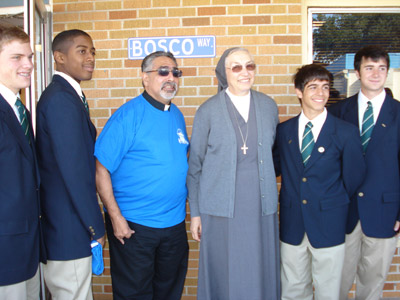 "Louisiana. Visit of M. Yvonne Reungoat to the province ""St. Philip the Apostle"" (SUA). With  Fr. John Di Fiore sdb and some students from ""Archbishop Shaw High School."""