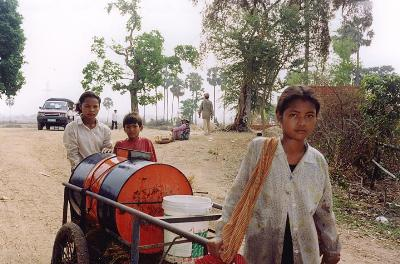 Children transporting water.