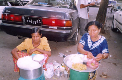 Two street sellers in Yangon.