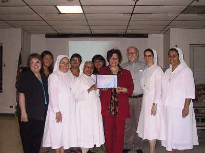 Sr Maritza Ortiz, Sr Maria Guadalupe Medina, Carolina Fiorica with the Past Pupil Union of San Antonio
