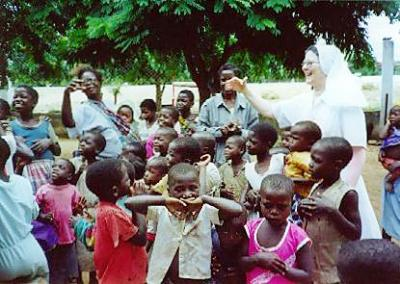 Sr. Ciri interacts with a group of children in a village on the Congo border