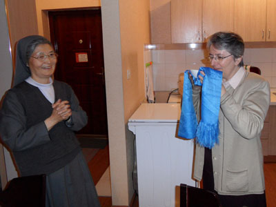 Ulaanbaatar. Visit of Sr. Alaide Deretti to the province of Korea-Mongolia(KOR).Welcome in the Mongolian rite: a cup of milk with a blue cloth.